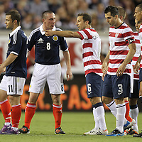 United States Defenseman Steve Cherundolo (6) and Scotland Midfielder Scott Brown (8) argue during an international friendly soccer match between Scotland and the United States at EverBank Field on Saturday, May 26, 2012 in Jacksonville, Florida.  The United States won the match 5-1 in front of 44,000 fans. (AP Photo/Alex Menendez)