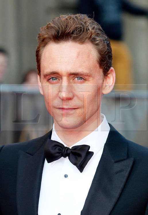 © Licensed to London News Pictures. 13/04/2014, UK. Tom Hiddleston, The Laurence Olivier Awards, Royal Opera House, London UK, 13 April 2014. Photo credit : Richard Goldschmidt/Piqtured/LNP