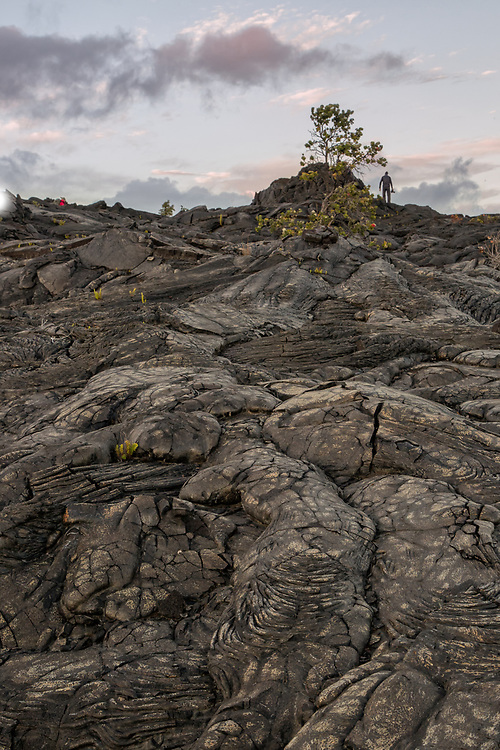 Photographer exploring lava flow, Volcanos National Park, Hawaii Lava flow pattern, Volcanos National Park, Hawaii
