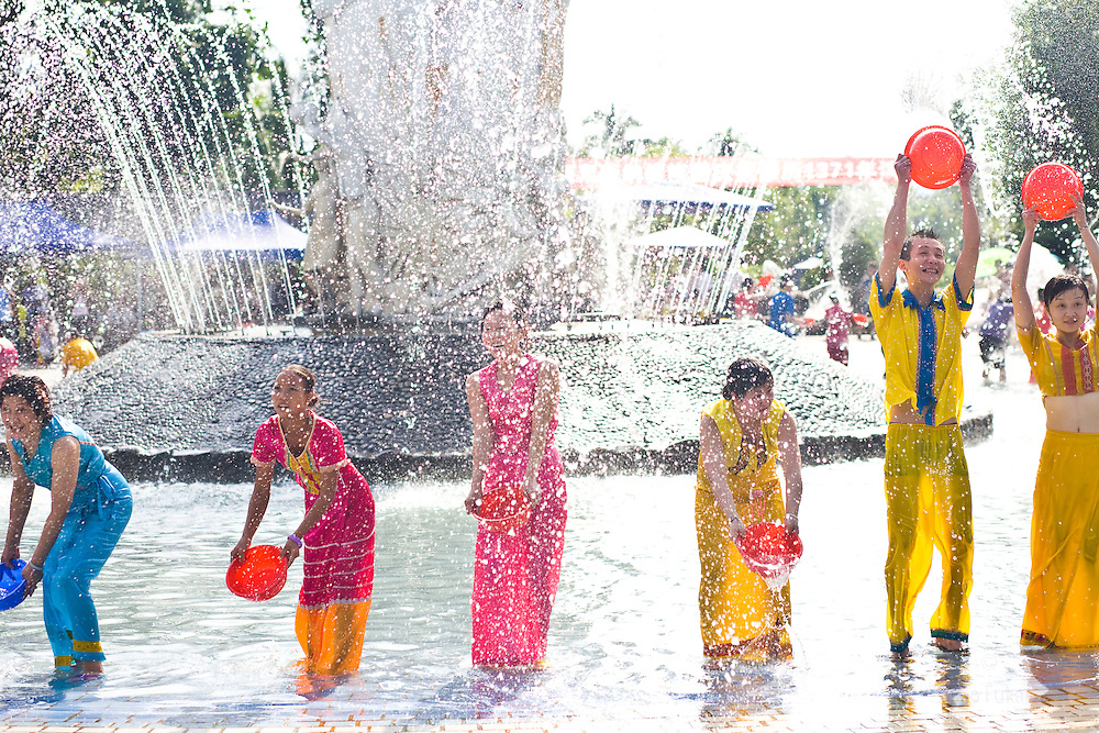 People participate in Water Splashing at the Dai Minority park in Yunnan, China.