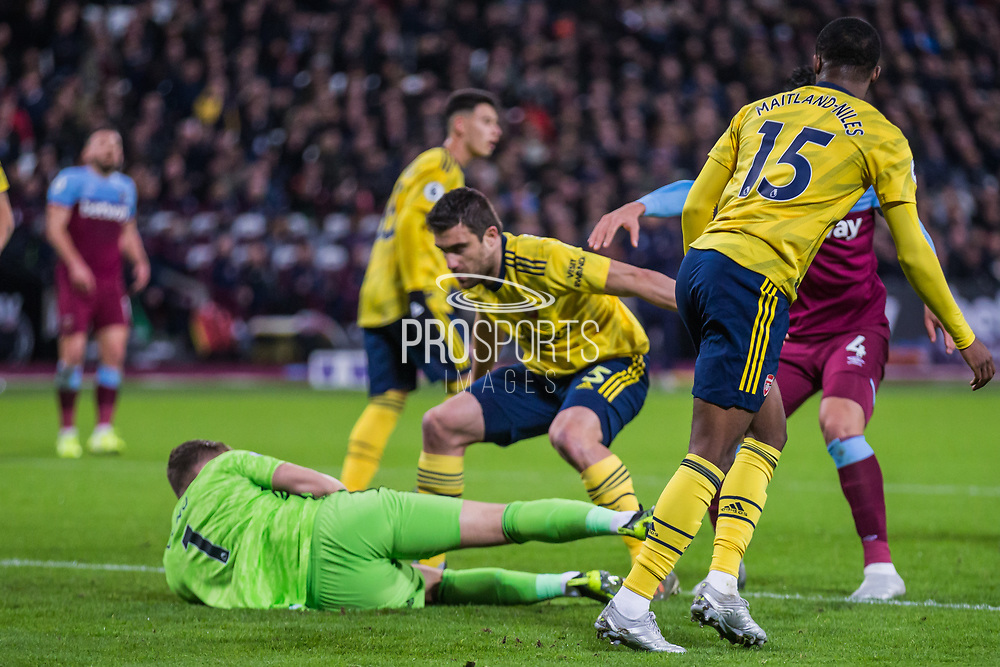 Bernd Leno (GK) (Arsenal) saves the ball from Fabian Balbuena (West Ham) during the Premier League match between West Ham United and Arsenal at the London Stadium, London, England on 9 December 2019.