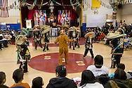 Middletown, New York - Dancers in traditional costumes perform for members of St. Joseph's Church during a celebration of  the Festival of Nuestra Senora de Guadalupe in the church gymnasium on Saturday, Dec. 14, 2013.