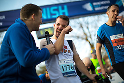 © Licensed to London News Pictures . 15/10/2017 . Manchester , UK . Athlete PATRICK BARDEN from Kent , who has Cerebral Palsy , reaches the finish line having raced over three days , in the Greater Manchester Half Marathon in Old Trafford . Photo credit : Joel Goodman/LNP