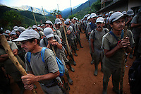 Workers hired by the Colombian government to manually eradicate coca crops stand in at roll call before their hike out to the coca fields to begin work in El Campanario, in a remote area of the southern Colombian state of Nariño, on Friday, June 22, 2007. (Photo/Scott Dalton)