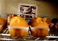 A poster of a film is tacked to a wall behind freshly baked cake, at Maiwand Market, in Fremont, Ca., on Saturday, March, 7, 2009.