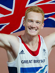 © Licensed to London News Pictures. 04/08/2012. London,Britain.Great Britain's Greg Rutherford celebrates after wining the gold medal at the Long Jump, at the Olympic Stadium, in London, during the London 2012 Olympic Games.  Photo credit : Bogdan Maran/LNP/BPA
