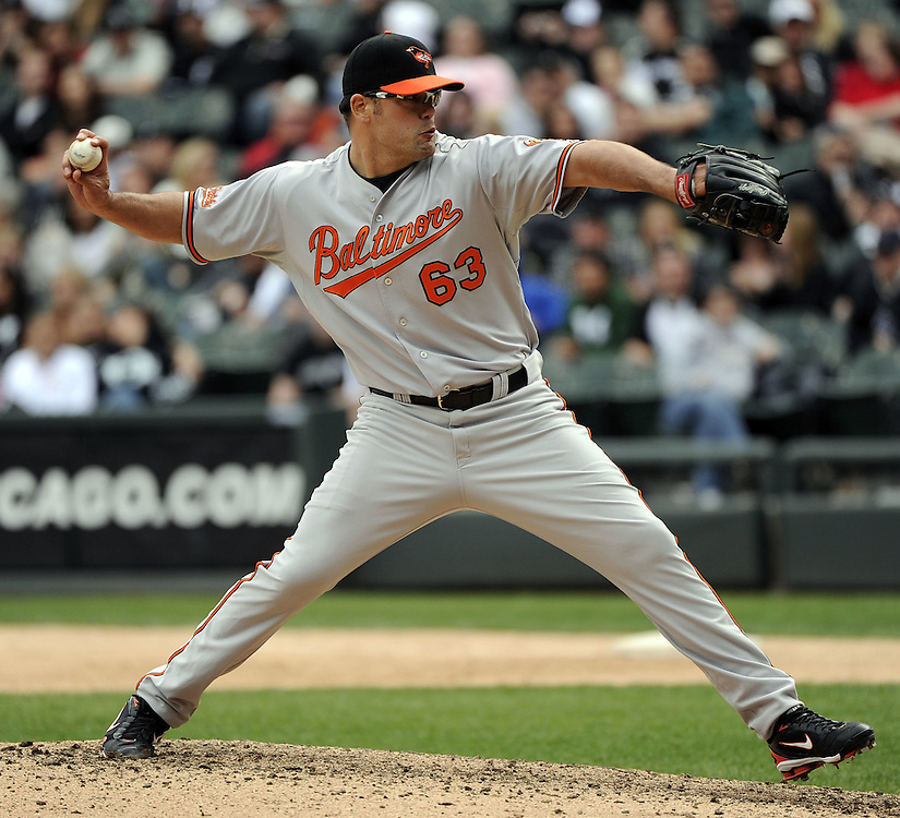 CHICAGO - MAY 01:  Kevin Gregg #63 of the Baltimore Orioles pitches against the Chicago White Sox on May 01, 2011 at U.S. Cellular Field in Chicago, Illinois.  The Orioles defeated the White Sox 6-4.  (Photo by Ron Vesely)  Subject:   Kevin Gregg