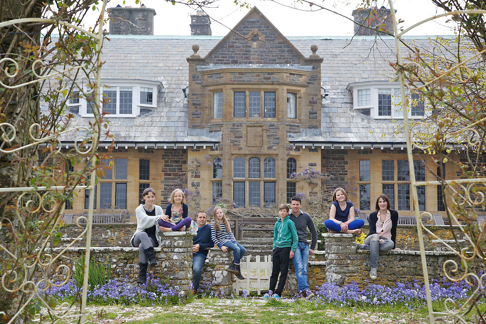 The Elliott and Baker families in the garden at Pickwell Manor. From left to right: Tracey Elliott, Millie-grace Elliott (8), Richard Eliott, Molly Elliott (10), Zac Baker (11), Steve Baker, Liza Baker (9), Susannah Baker. Pickwell Manor, Georgeham, North Devon, UK.<br /> CREDIT: Vanessa Berberian for The Wall Street Journal<br /> HOUSESHARE