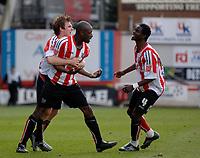 Photo: Daniel Hambury.<br />Brentford v Blackpool. Coca Cola League 1. 17/04/2006.<br />Brentford's Lloyd Owusu celebrates his goal.