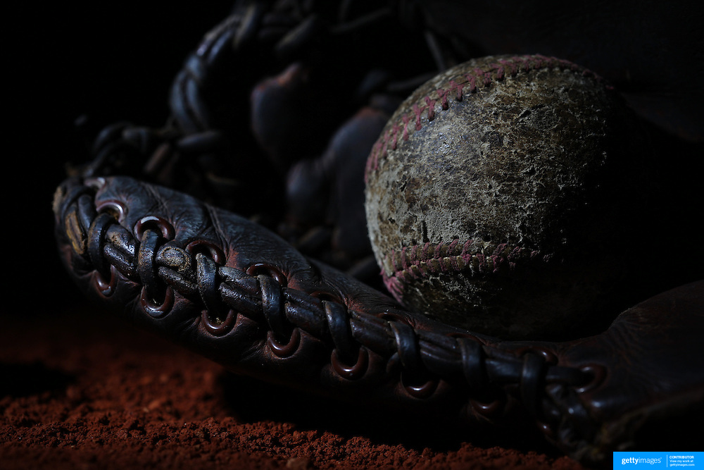 A vintage antique baseball glove and used baseball. 7th June 2012. Photo Tim Clayton
