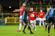 Manchester United midfielder Bruno Fernandes (18) beats Club Brugge defender Clinton Mata (77) to the ball during the Europa League match between Club Brugge and Manchester United at Jan Breydel Stadion, Brugge, Belguim on 20 February 2020.
