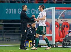 NANNING, CHINA - Thursday, March 22, 2018: Wales' hat-trick hero Gareth Bale is congratulated by new manager Ryan Giggs as he is substituted after scoring the sixth goal during the opening match of the 2018 Gree China Cup International Football Championship between China and Wales at the Guangxi Sports Centre. (Pic by David Rawcliffe/Propaganda)