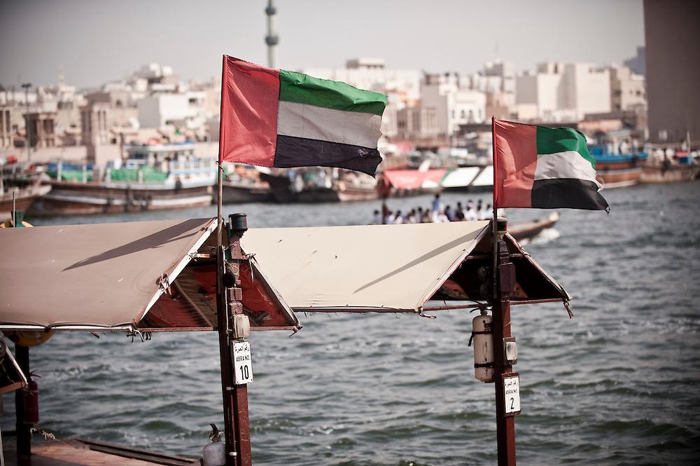 UAE flags flutter on abras on the Dubai creek, Bur Dubai, Dubai, UAE. Archive of images of Dubai by Dubai photographer Siddharth Siva