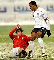 Fotball<br /> 27 mars 2009<br /> Landskamp<br /> Norge U21 - England U21<br /> Cato Hansen , Norge i takling med Tom Huddlestone , <br /> England<br /> Foto: Reidar Talset , Digitalsport