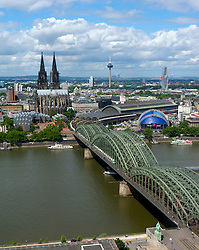 Skyline view of city of Cologne with Hohenzollern Bridge crossing the River Rhine and historic Dom or Cathedral Germany