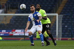 Adam Armstrong of Blackburn Rovers in action with Anthony Grant of Peterborough United - Mandatory by-line: Joe Dent/JMP - 19/04/2018 - FOOTBALL - Ewood Park - Blackburn, England - Blackburn Rovers v Peterborough United - Sky Bet League One
