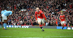 Wayne Rooney of Manchester United celebrates scoring their second goal during the Barclays Premier League match between Manchester United and Manchester City at Old Trafford on February 12, 2011 in Manchester, England.