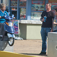 "An actress sitting on a scooter in a  precarious situation pranks a couple at the Santa Monica Pier  during the filming of  NBC's new hidden-camera comedy show titled ""Betty White's Off Their Rockers"" (working title) on Thursday, December 1, 2011."