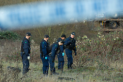 © Licensed to London News Pictures . 29/12/2018 . Wigan , UK . Police conduct a search at the scene where they have taped off a stretch of Bickershaw Lane in Abram . GMP report they have arrested two people on suspicion of attempted murder and for conspiracy to commit attempted murder , respectively , after a 21-year-old man , identified locally as Billy Livesley , sustained life-threatening injuries yesterday evening (Friday 28th December 2018) . Photo credit : Joel Goodman/LNP