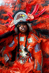 27 April 2013. New Orleans, Louisiana,  USA. .New Orleans Jazz and Heritage Festival. Ty,Shun Watson (9 yrs) of the 'Mohicans' tribe of Mardi Gras Indians..Photo; Charlie Varley.