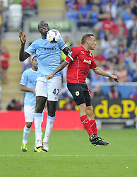 Manchester City's Yaya Touré battles for the high ball with Cardiff City's Craig Bellamy  - Photo mandatory by-line: Joe Meredith/JMP - Tel: Mobile: 07966 386802 25/08/2013 - SPORT - FOOTBALL - Cardiff City Stadium - Cardiff -  Cardiff City V Manchester City - Barclays Premier League
