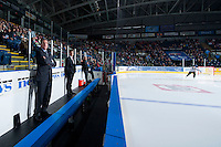 KELOWNA, CANADA - FEBRUARY 14: Head coach Tim Hunter of Moose Jaw Warriors stands on the bench at the start of the game against the Kelowna Rockets on February 14, 2015 at Prospera Place in Kelowna, British Columbia, Canada.  (Photo by Marissa Baecker/Shoot the Breeze)  *** Local Caption *** Tim Hunter;