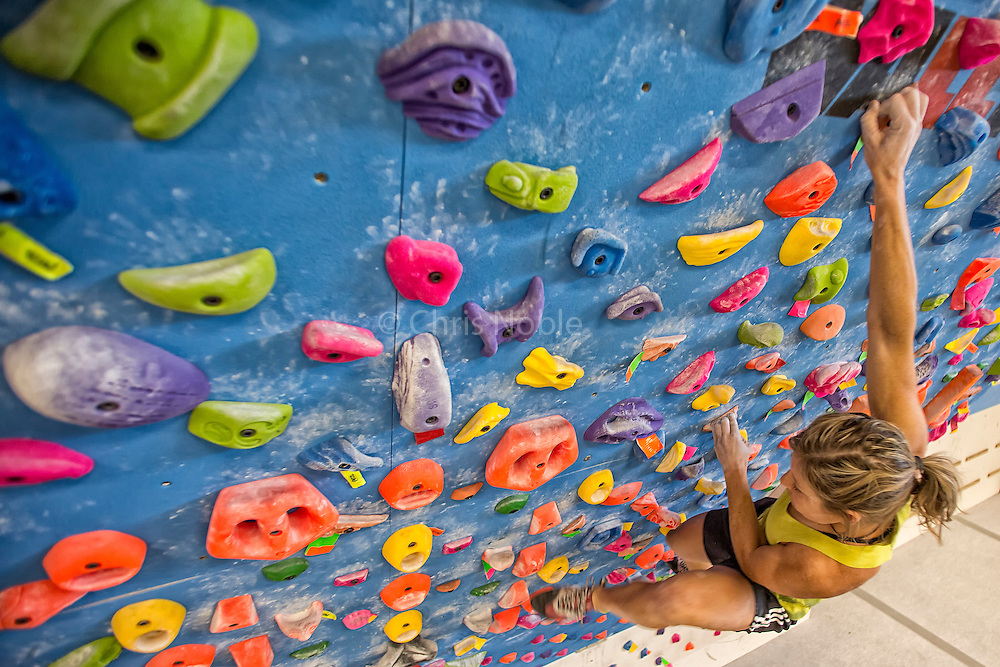 Pro climber Mayan Smith-Gobat training for climbing on a systems board in Grand Junction Colorado.