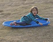 grass sledding-holeman