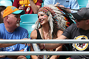 Sunday, October 13, 2019; Miami Gardens, FL USA;  Excited Washington Redskins fans cheer for their team during an NFL game against Miami at Hard Rock Stadium. The Redskins beat the Dolphins 17-16. (Kim Hukari/Image of Sport)