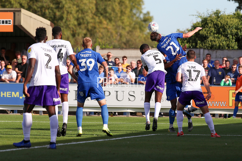AFC Wimbledon defender Ryan Delaney (21) beating Shrewsbury Town defender Ro-Shaun Williams (5) to win header during the EFL Sky Bet League 1 match between AFC Wimbledon and Shrewsbury Town at the Cherry Red Records Stadium, Kingston, England on 14 September 2019.