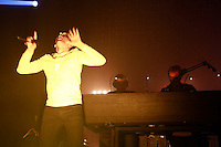 Underworld performing at Roseland Ballroom on October 27, 2010. .Karl Hyde lead vocals and guitar, .Rick Smith with glasses on keyboards. Darren Price keyboards..