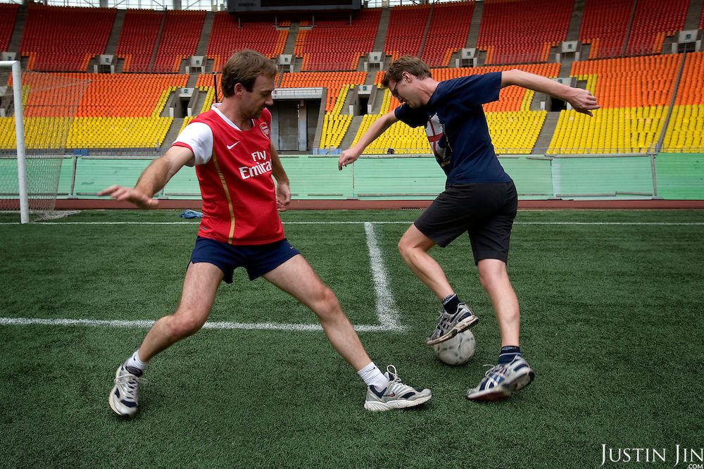 Guardian journalists Luke Harding (in blue) and Tom Parfitt (in red) play football on artificial turf that covers the Luzhniki stadium. England will play Russia in October 2007 in the Euro 2008 match on this turf.