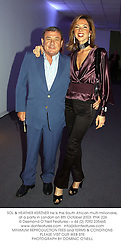 SOL & HEATHER KERZNER he is the South African multi-millionaire, at a party in London on 8th October 2003.PNK 226