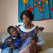 "Atlanta, Georgia/Central Africa Republic Refugee/Nestorine Lakas, 27, holds her son Eric who has cerebral palsy, at their apartment in Atlanta. Nestorine arrived in the U.S. in 2010 with her two young children from the Central African Republic. Her son, who is now 7 years old, suffers from severe cerebral palsy and requires a wheelchair and specialized healthcare. At the IRC in Atlanta, Nestorine is part of the Temporary Assistance for Needy Families (TANF) program where she is learning English, job skills and basic computer literacy so she can support her family as a single mom and learn how to manage her son's health needs. Unfortunately the father of Nestorine's children was not able to come to the U.S. with her, so she cares for her children and dreams of reuniting with him someday. Nestorine believes what makes her successful is ?working hard and overcoming challenges?. ""There was a war in my country and I fled to Cameroon. I was pregnant with my older son and gave birth along the way. When I fled I was alone. When I got to the camp I found my husbands name on a sign at the camp and we were reunited. My daughter Carol was born in Cameroon."" Because of her son's disability, Nestorine got a humanitarian visa with the help of UNHCR. ""I am very happy to be here because they helped me a lot with my child. If I had stayed in CAR there isn't the healthcare that I have here. I am very thankful. The reason my child is still alive because I came as a refugee. Maybe the child would not have had any hope to walk. I hope one day he might walk.""."