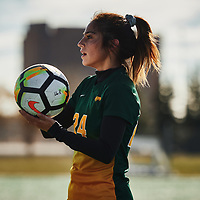 4th year defender, Brigit Sinaga (24) of the Regina Cougars during the Women's Soccer home game on Sun Oct 14 at U of R Field. Credit: Arthur Ward/Arthur Images
