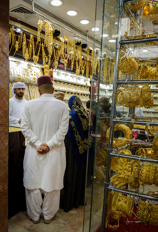 UNITED ARAB EMIRATES, DUBAI - CIRCA JANUARY 2017: Locals shopping for jewelry at the famous Gold Souq in Dubai