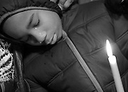 People attend a vigil for Kasreeyal Hester, 16, of Gary, and Mark Skipper, 15, of Hammond, were found shot to death in Gary, Ind., on February 6, 2106.