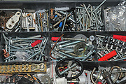 Close-up of screws and nails in a compartmental box