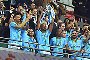 Vincent Kompany (4) of Manchester City lifts the Carabao Cup after City won on penalties after the final finished 0-0 after extra time during the Carabao Cup Final match between Chelsea and Manchester City at Wembley Stadium, London, England on 24 February 2019.