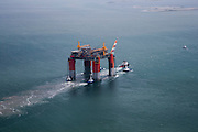 """Offshore oil platform """"DELTA HOUSE"""" being towed offshore from Kiewit in Ingleside, Texas by Crowley Maritime Corporation's OCEAN CLASS Tugs. (Photography by Tim Burdick)"""
