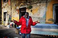 Rosarno, Italia - 19 dicembre 2010. Un immigrato all'esterno della sua casa abbandonata in cui vive a Rosarno..Ph. Roberto Salomone Ag. Controluce.ITALY - An immigrant outside his house in Rosarno on December 19, 2010.