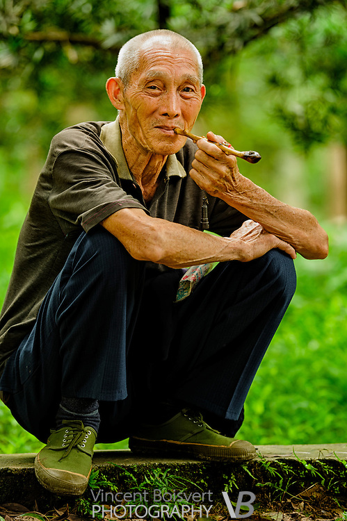 An old chinese smoking pipe in Yangshuo Park, Yangshuo, china