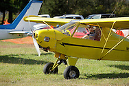 Wurtsboro, New York - A pilot in a Rocky Mountain Wings Ridge Runner Ultralight airplane taxis to the runway at Wurtsboro Airport for the annual Fly In - Drive- In Breakfast on Oct. 9, 2011. The plane is an experimental model built from a kit.