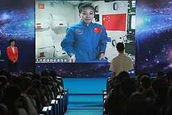 59870561  <br /> A student asks questions to the female astronaut Wang Yaping, one of the three crew members of Shenzhou-10 spacecraft at the High School Affiliated to Renmin University of China, in Beijing, capital of China, June 20, 2013. A special lecture began Thursday morning, given by a teacher aboard China s space module Tiangong-1 to students on Earth, Thursday June 20, 2013.<br /> UK ONLY
