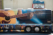 The Gibson Guitar bus parked in front of Antone's at the Clifford Antone tribute during South by Southwest 2009, Austin Texas, March 21, 2009.  Arc Angels are a blues rock band formed in Austin, Texas in the early 1990s. The band is composed of Doyle Bramhall II, Charlie Sexton, and Chris Layton.