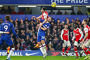 Arsenal defender Kieran Tierney (3) and Chelsea defender César Azpilicueta (28) clash in the air during the Premier League match between Chelsea and Arsenal at Stamford Bridge, London, England on 21 January 2020.