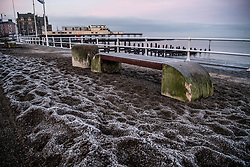 © Licensed to London News Pictures. 11/01/2018. Aberystwyth, UK. Ice and frost cover the promenade on a bitterly cold and frosty morning in Aberystwyth, with temperatures well below freezing after a night of clear cloudless skies. The Met Office has issued a yellow warning for fog, with very low visibility, for much of Wales, the west Midlands and the south west of the UK. Photo credit: Keith Morris/LNP