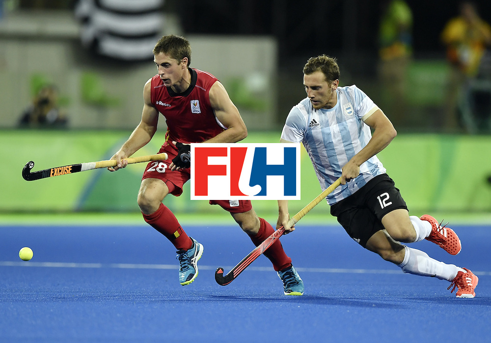 Belgium's Jerome Truyens (L) vies with Argentina's Lucas Vila during the men's Gold medal field hockey Belgium vs Argentina match of the Rio 2016 Olympics Games at the Olympic Hockey Centre in Rio de Janeiro on August 18, 2016. / AFP / PHILIPPE LOPEZ        (Photo credit should read PHILIPPE LOPEZ/AFP/Getty Images)