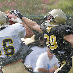 04 August 2009: New Orleans Saints tight end Buck Ortega (86) pulls down a touchdown catch over safety Chris Reis (39) in the rain during New Orleans Saints training camp at the team's practice facility in Metairie, Louisiana.