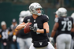 OAKLAND, CA - DECEMBER 09: Quarterback Derek Carr #4 of the Oakland Raiders warms up before the game against the Pittsburgh Steelers at the Oakland Coliseum on December 9, 2018 in Oakland, California. The Oakland Raiders defeated the Pittsburgh Steelers 24-21. (Photo by Jason O. Watson/Getty Images) *** Local Caption *** Derek Carr